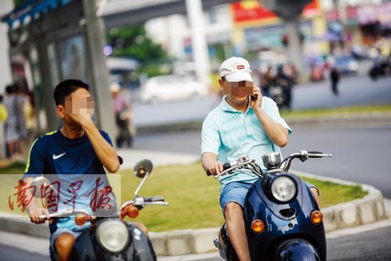 南宁明确规定:骑电动车打电话、撑雨伞罚50元
