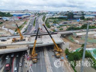 中铁十一局二公司南宁昆仑立交项目圆满完成快速路跨昆仑大道桥箱梁架设任务
