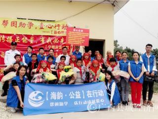 宁明县:爱心企业献爱心   真心帮扶显真心